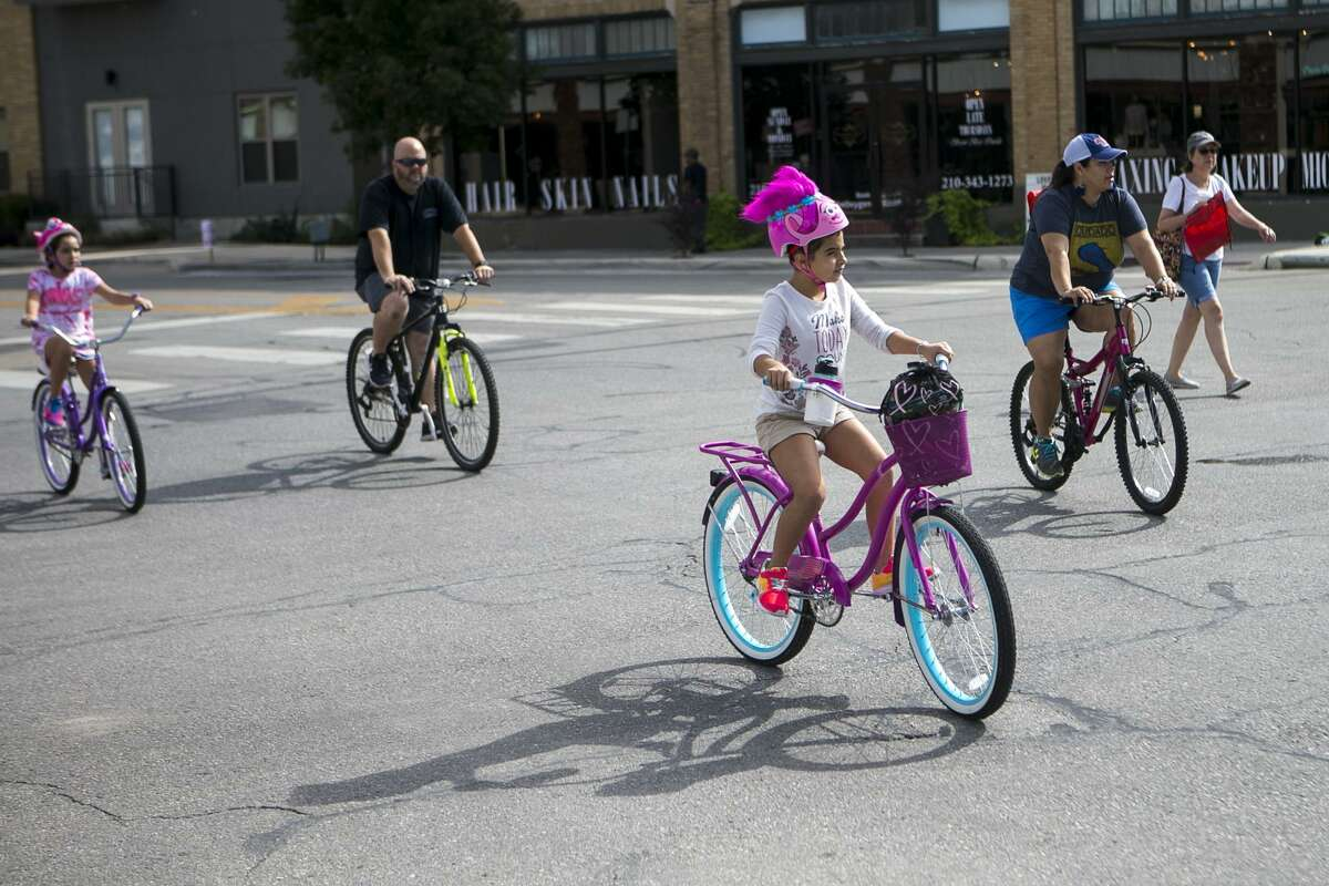 Bicyclists ride on Broadway north of downtown in San Antonio during Siclovia, a biannual event put on by the YMCA of Greater San Antonio on Sept. 30, 2018. With the streets closed to traffic, people were free to walk, ride bikes or play while getting some exercise.