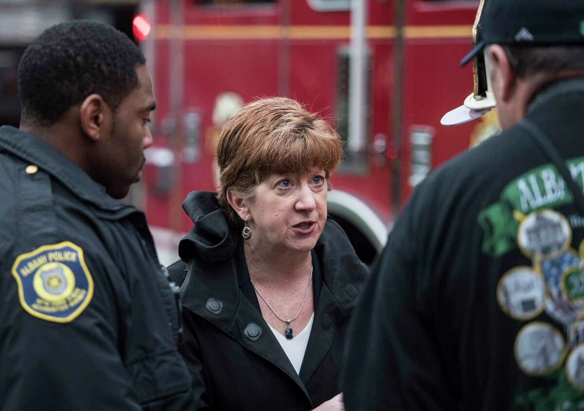 Albany Mayor Kathy Sheehan speaks with fire and police members as work at a multi alarm fire at a home at 148 Colonial Avenue Monday Oct. 1, 2018 in Albany, N.Y. (Skip Dickstein/Times Union)