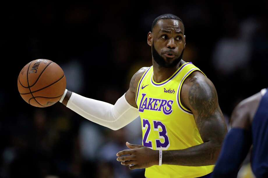 Los Angeles Lakers forward LeBron James looks to pass during the first half of an NBA preseason basketball game against the Denver Nuggets, Sunday, Sept. 30, 2018, in San Diego. (AP Photo/Gregory Bull) Photo: Gregory Bull, Associated Press / Copyright 2018 The Associated Press. All rights reserved