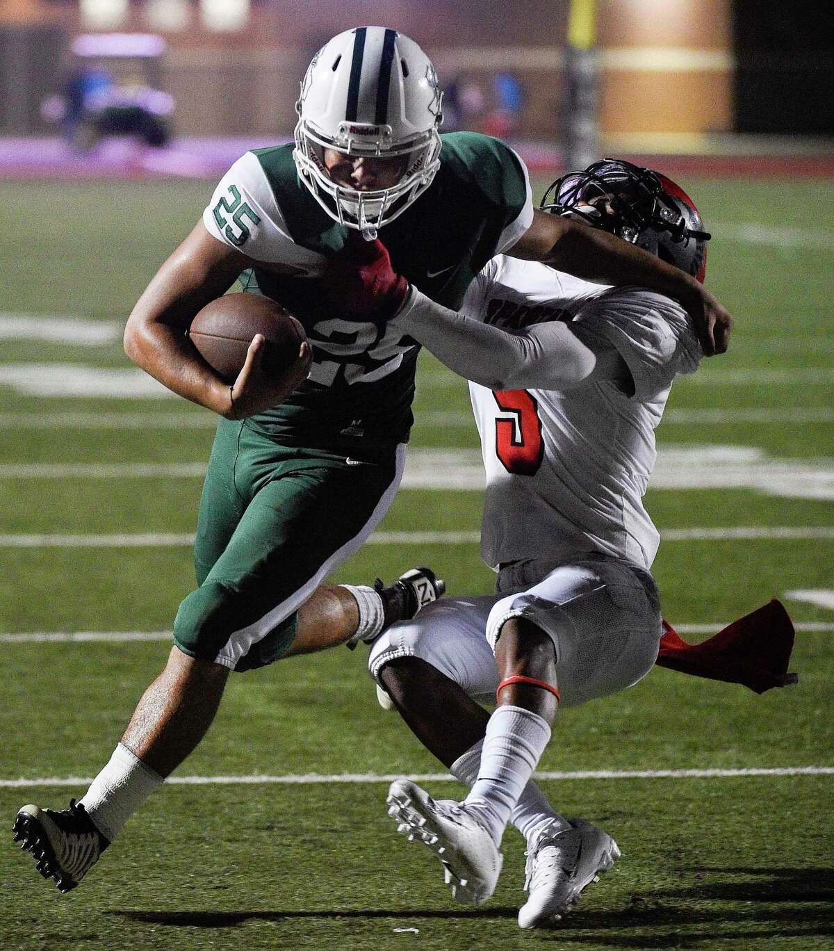 Kingwood Park running back Juan Garcia (25) pushes off Porter defensive back Kaleb Bailey during the second half of a high school football game, Saturday, Sept. 29, 2018, in Humble, TX. (Eric Christian Smith/Contributor)