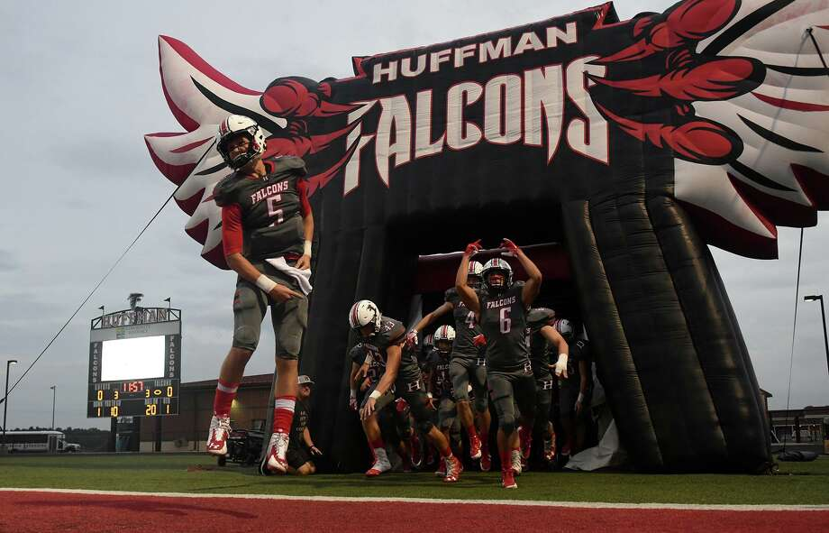 Huffman-Hargrave junior quarterback Justin Shively (5) leads his teammates onto the field before the start of the Falcon's matchup with Concordia Lutheran at Falcon Stadium in Huffman on Sept. 28, 2018. Photo: Jerry Baker, Houston Chronicle / Contributor / Houston Chronicle