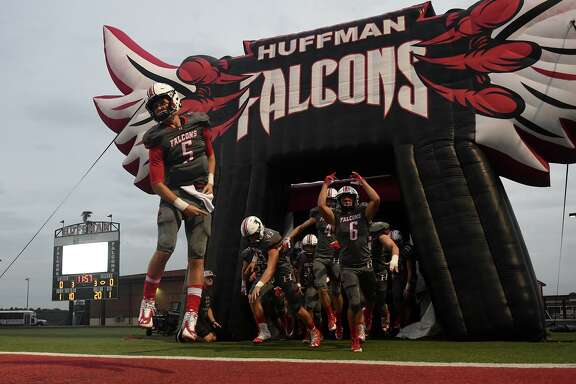 Huffman-Hargrave junior quarterback Justin Shively (5) leads his teammates onto the field before the start of the Falcon's matchup with Concordia Lutheran at Falcon Stadium in Huffman on Sept. 28, 2018.