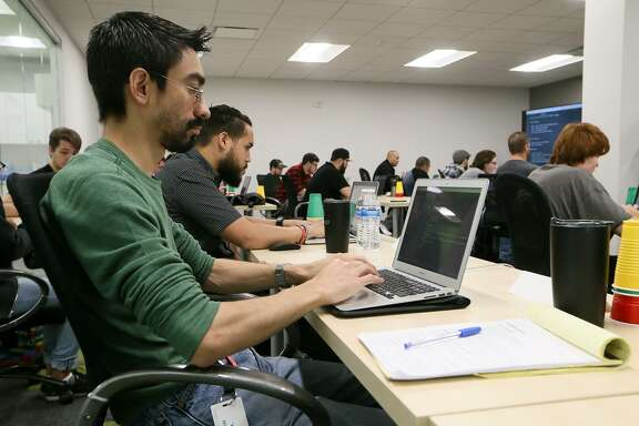 Joaquin Silva (left) learns programming skills in a Web Development I class at Codeup, a company downtown that offers coding bootcamps for aspiring software developers at 600 Navarro St. #350 on Tuesday, Sept. 25, 2018.