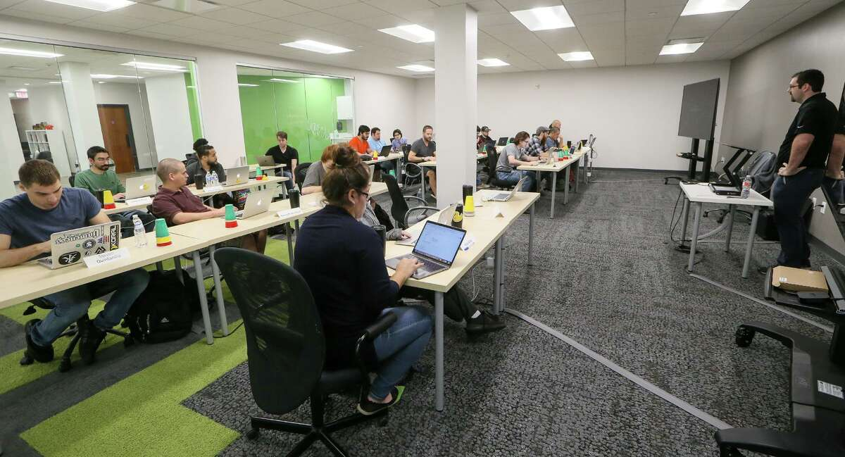 Students learn programming skills in a Web Development I class at Codeup, a company downtown that offers coding boot camps for aspiring software developers.