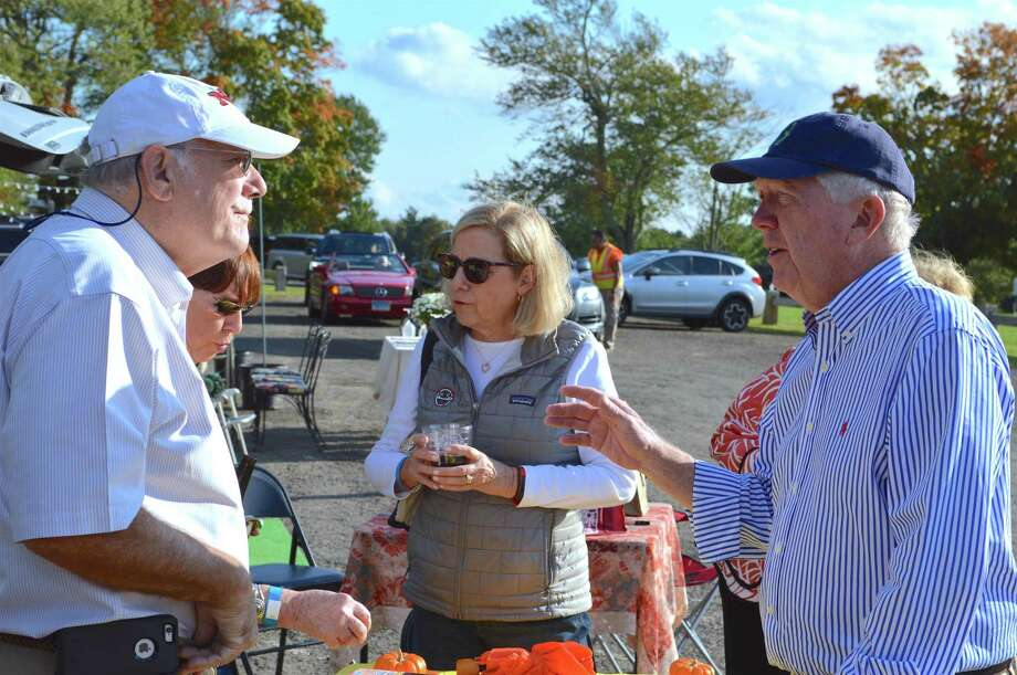 Bailey Stewart of New Canaan, left, talks with friend First Selectman Kevin Moynihan at the 3rd annual Tailgate Party at Waveny Park, Saturday, Sept. 29, 2018, in New Canaan, Conn. Photo: Jarret Liotta / For Hearst Connecticut Media / New Canaan News Freelance