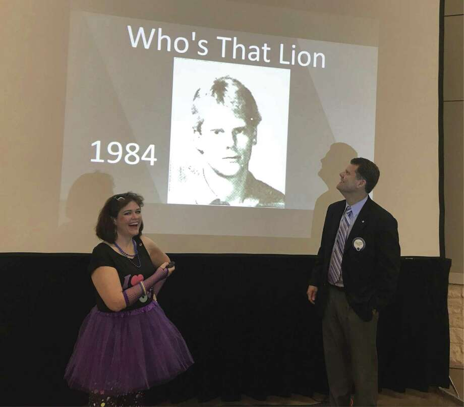 In sticking with President Bobby Brennan's (at right) '80 new members in our 80th year'; the Membership Services Committee used the 80's theme for their 'Shake it Up' meeting on Wednesday, as committee member Melissa Bessey, left, surprised a few members with a look back to their 80's.
