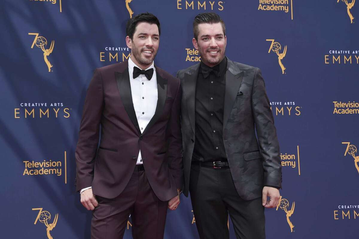Drew Scott, left, and Jonathan Scott arrive at night two of the Creative Arts Emmy Awards at The Microsoft Theater on Sunday, Sept. 9, 2018, in Los Angeles. (Photo by Richard Shotwell/Invision/AP)