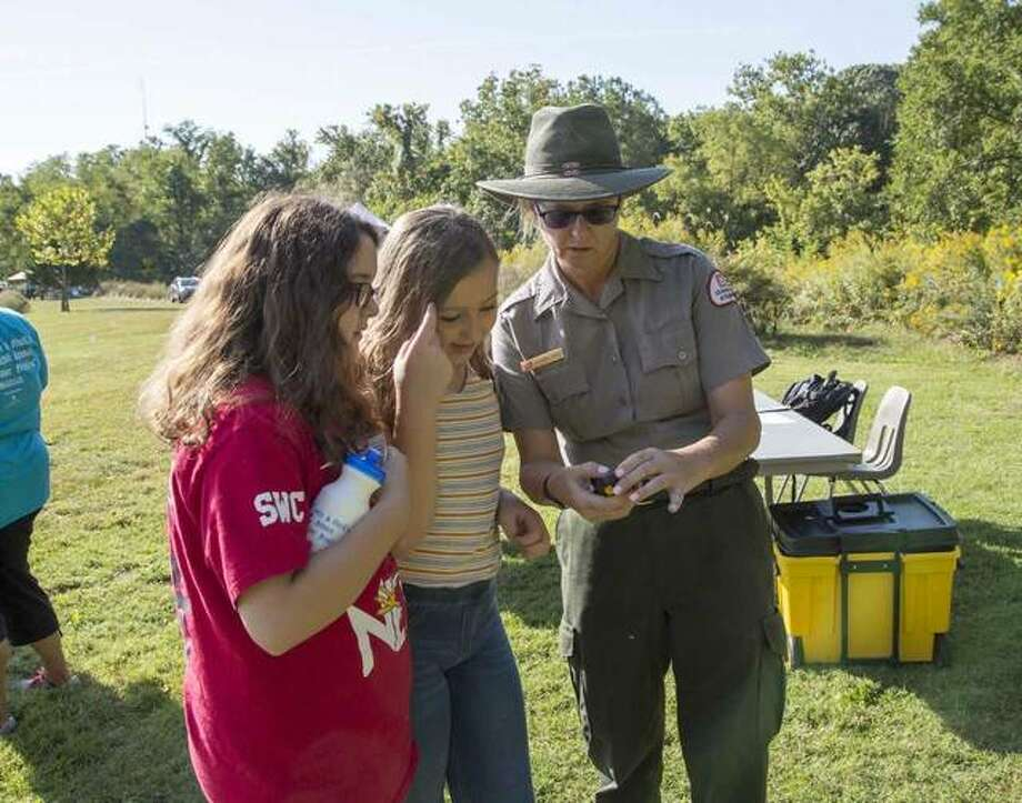 """Leighann Jones of the U.S. Army Corps of Engineers teaches students about """"Critters of the River"""" in a geocaching scavenger hunt during the 2018 Water Festival at Lewis and Clark Community College. Photo: Courtesy Of Lewis And Clark Community College"""