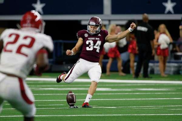 Texas A&M Aggie kicker Braden Mann (34) kicks off during the first half of an NCAA college football game against the Arkansas Razorbacks, Saturday, Sept. 29, 2018, in Arlington, Texas. (AP Photo/Roger Steinman)