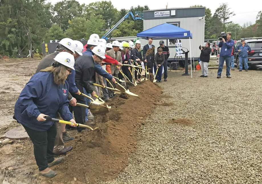 East Hampton broke ground for the new town hall/police station Friday afternoon. About 80 people attended. The 33,000-square-foot, two-story building will be built on a 5.4-acre parcel of plan in the Edgewater Hills mixed-use development. Photo: Jeff Mill / Hearst Connecticut Media