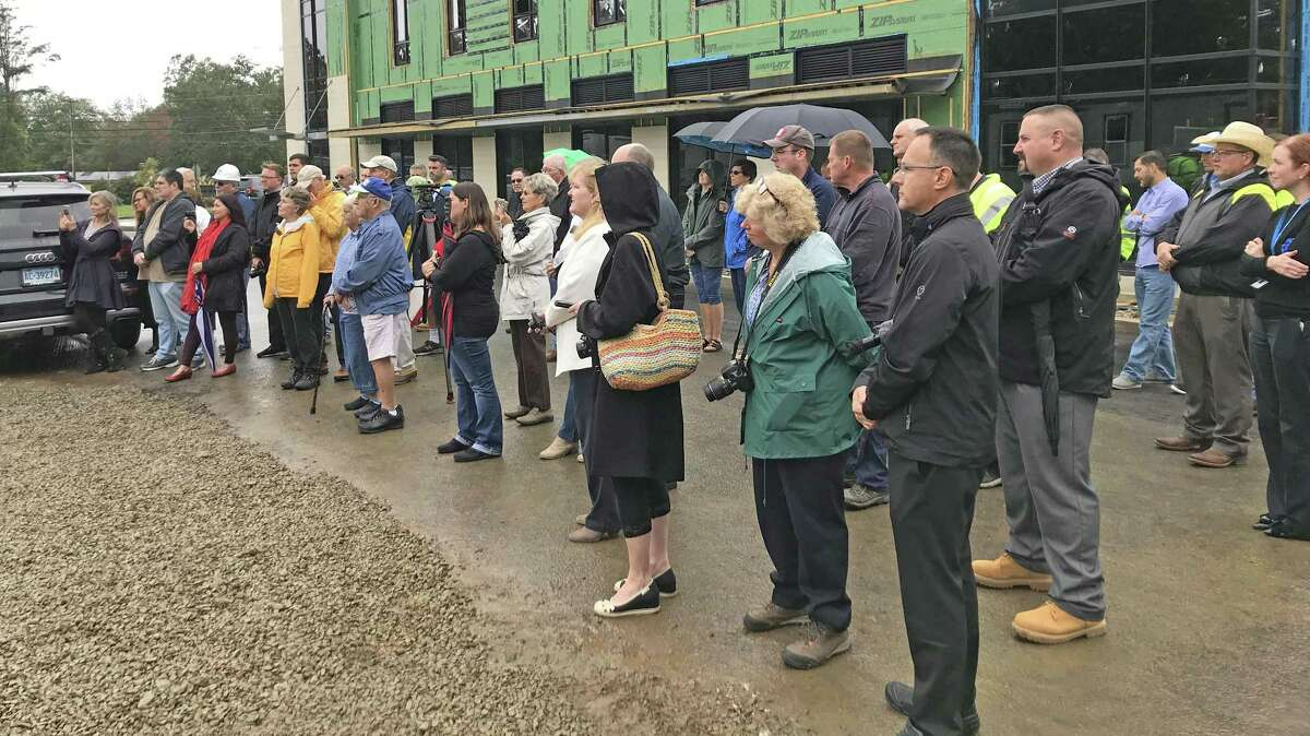 East Hampton broke ground for the new town hall/police station Friday afternoon. A crowd of some 80 people, the majority of them town employees and police officers, attended.The 33,000-square-foot, two-story building will be built on a 5.4-acre parcel of plan in the Edgewater Hills mixed-use development.