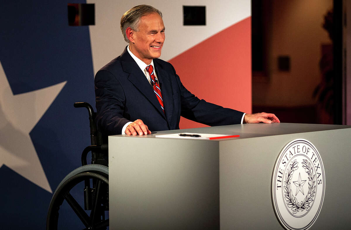 PHOTOS: On the issues Texas Gov. Greg Abbott smiles before a gubernatorial debate against his Democratic challenger Lupe Valdez at the LBJ Library in Austin, Texas, on Friday, Sept. 28. >>See where Ted Cruz and Beto O'Rourke stand on key issues...