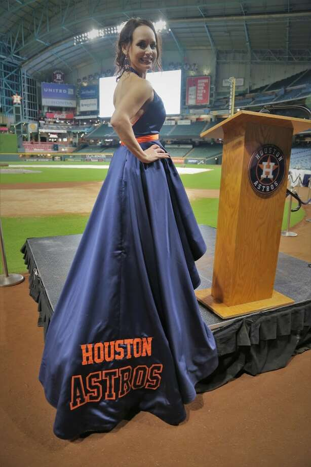 Lumberton seamstress Cookie Merriman created this Houston Astros ballgown for Jennifer Walsh, vice president of the Goose Creek CISD Education Foundation. Walsh had the dress fashioned for the All-Star Gala Sept. 29, 2018 at Minute Maid Park. Photo: Provided By Jennifer Walsh