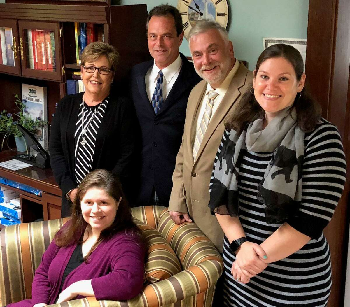GeronNursing & Respite Care in New Milford is celebrating its 30th year this year. The agency is owned by Michael Gold, second from left in back. Joining Gold are Alyssa Krasowski, on-call coordinator, front, and in back, from left to right, Linda Fecko, director of human resources, Roger Arguello, chief finance officer, and Jaime Pol, assistant administrator.