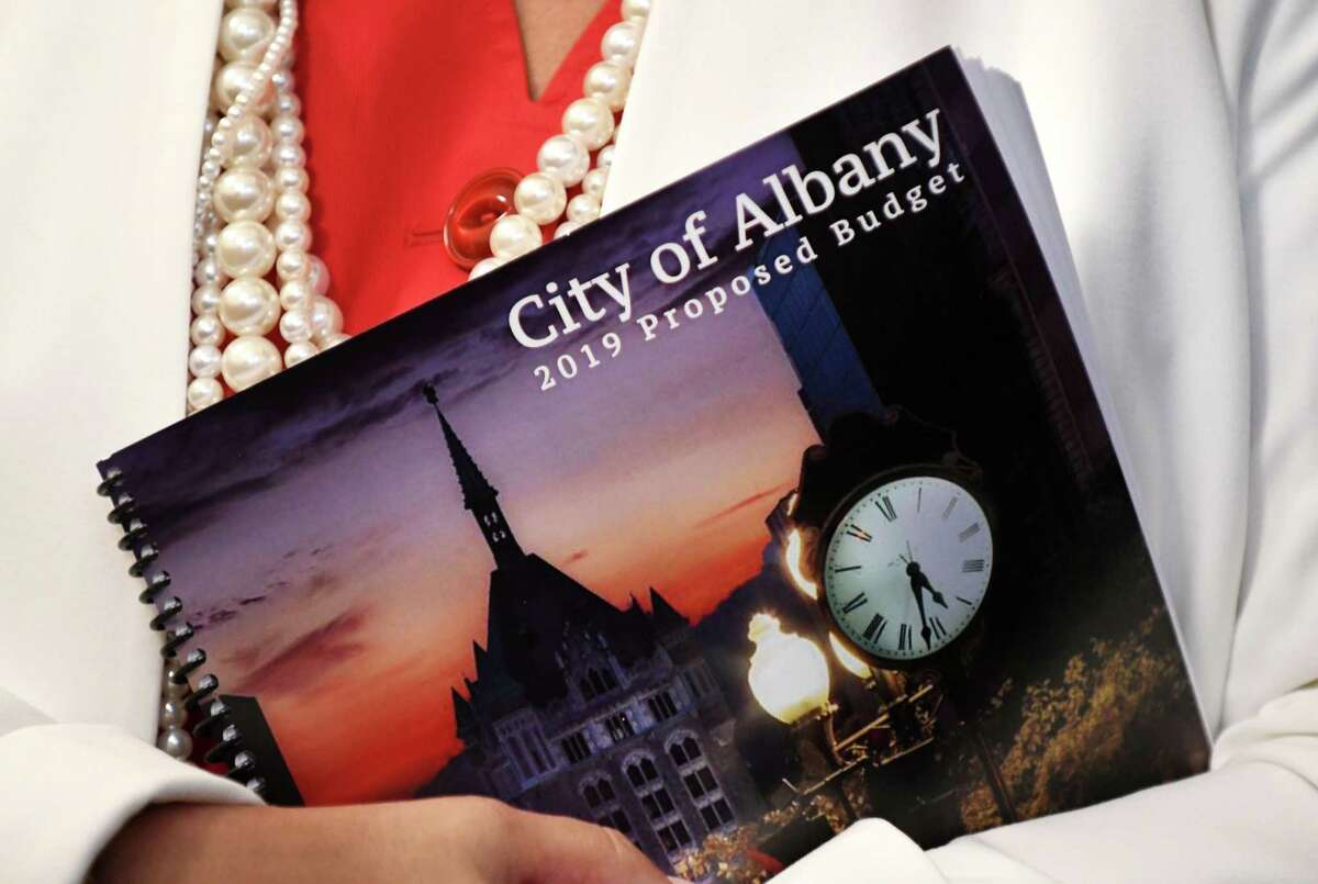 Susan Rizzoon, Albany's chief city auditor, holds a copy of Mayor Kathy Sheehan's 2019 proposed budget on Monday, Oct. 1, 2018, during a press conference at City Hall in Albany, N.Y. (Will Waldron/Times Union)