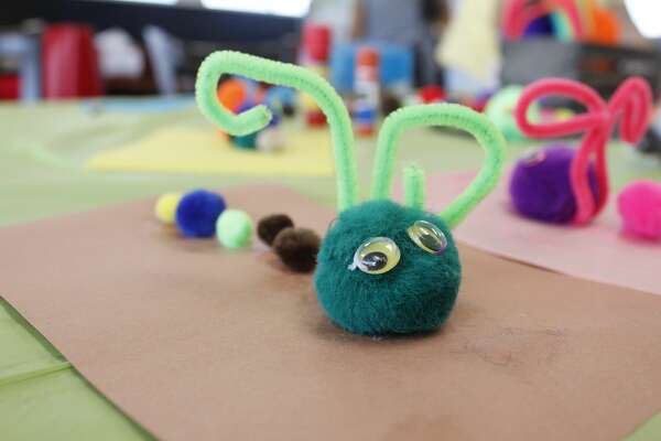 """Chickn4U at Billy Hext Road and Highway 191 hosted a family-friendly event 9/29/18. Kids made free arts and crafts caterpillars and read """"The Very Hungry Caterpillar.""""The celebration was a culmination of a month-long effort to donate a percentage of every sale at Chickn4U to the West Texas Food Bank's Hunger Action Month initiative. The event included book giveaways and ajumper on site."""