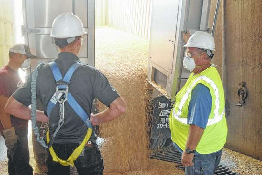 Chapin Farmers Elevator Co. employees unload a truck filled with corn for storage. Photo: Nick Draper | Journal-Courier