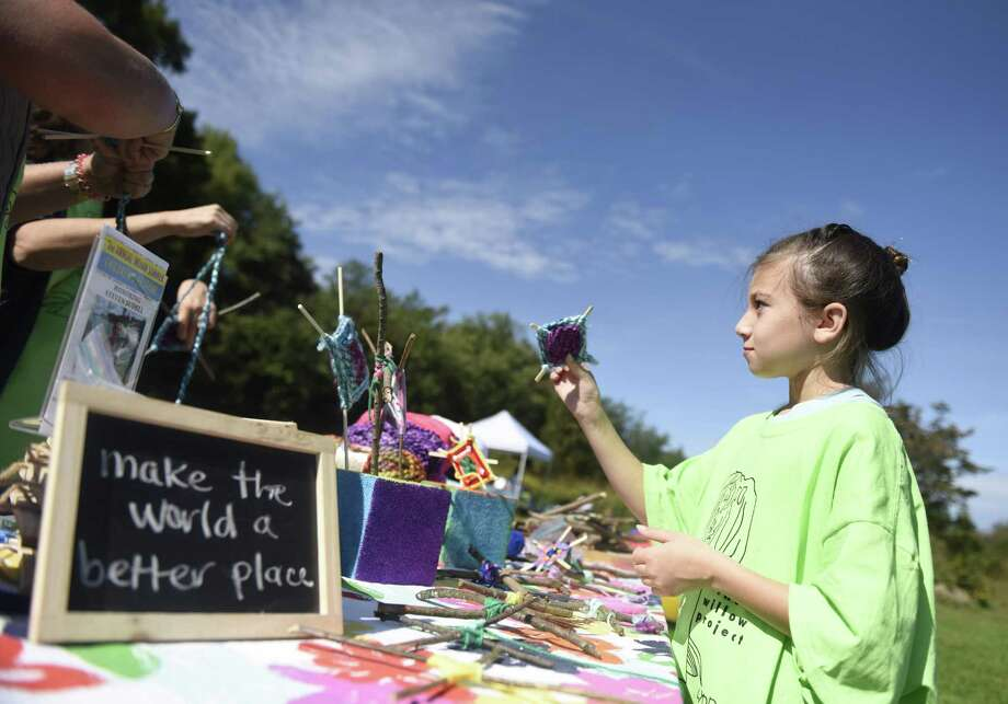 "Greenwich's Ava Hagerty, 9, shows her ""God's eye"" weaving craft at the second annual Indian Summer Children's Festival at Audubon Greenwich in Greenwich, Conn. Sunday, Sept. 30, 2018. Attractions included live music, beer and wine tasting, children's games, face-painting, a bounce house, dancing, yoga, a scavenger hunt, and raffle. The event raised money for The Willow Project, which provides financial support for children and families battling cancer. The foundation was started for Greenwich girl Lynn Gulli, who had a rare form of leukemia that is now in remission after more than a year of aggressive treatment. Photo: Tyler Sizemore / Hearst Connecticut Media / Greenwich Time"