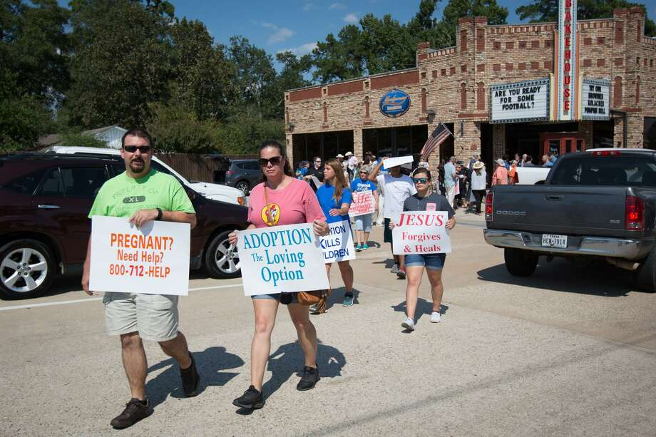 Participants of the Life Chain event make their way from Montgomery Bakehouse to spread out along Texas 105 on Sunday, Oct. 1, 2017, in Conroe. This year's Life Chain event is set for Sunday at 2 p.m. at Montgomery Backhouse in Conroe. Photo: Michael Minasi, Staff Photographer / Houston Chronicle / © 2017 Houston Chronicle