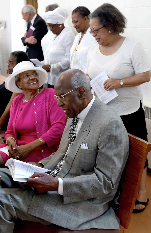 In this file photo, choir member Sharyn Esdaile, right, with Jan Parker, left, and her husband, former State Treasurer Henry Parker, during a church service at the Dixwell United Church of Christ in New Haven in 2015. Photo: Peter Hvizdak / Hearst Connecticut Media File Photo / ©2015 Peter Hvizdak