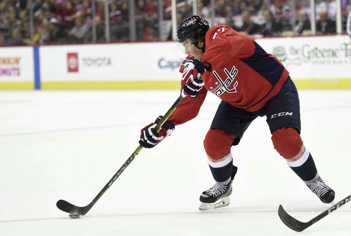 Washington Capitals right wing T.J. Oshie skates with the puck during the first period of an NHL preseason hockey game against the Boston Bruins in Washington D.C., on Sept. 18, 2018. The Capitals are the defending Stanley Cup champions.