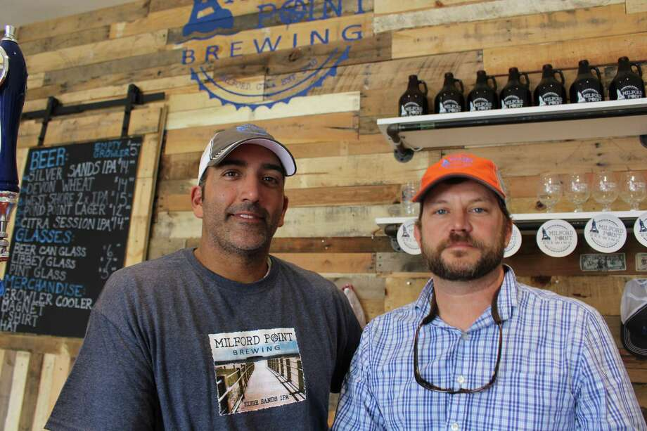 Jerry Candido, left, and Chris Willett are the owners of Milford Point Brewing Co. Photo: Jordan Grice / Hearst Connecticut Media / Connecticut Post