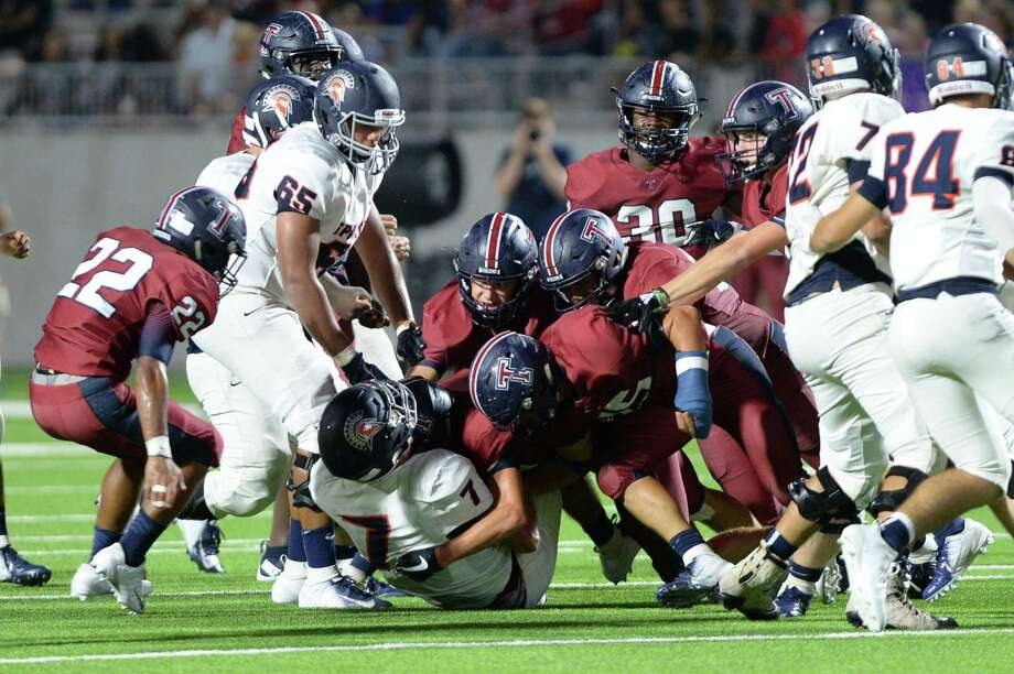 Quarterback Michael Batton (7) of Seven Lakes is gang tackled in the fourth quarter of a high school football game between the Tompkins Falcons and Seven Lakes Spartans on Friday, September 28, 2018 at Legacy Stadium, Katy, TX. Photo: Craig Moseley, Houston Chronicle / Staff Photographer / ©2018 Houston Chronicle