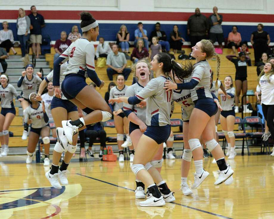 The Falcons celebrate a point in the second set of a high school volleyball match between the Tompkins Falcons and the George Ranch Longhorns on Sept. 4 at Tompkins High School. Photo: Craig Moseley, Staff / Staff Photographer / ©2018 Houston Chronicle