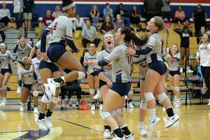 The Falcons celebrate a point in the second set of a high school volleyball match between the Tompkins Falcons and the George Ranch Longhorns on Sept. 4 at Tompkins High School.