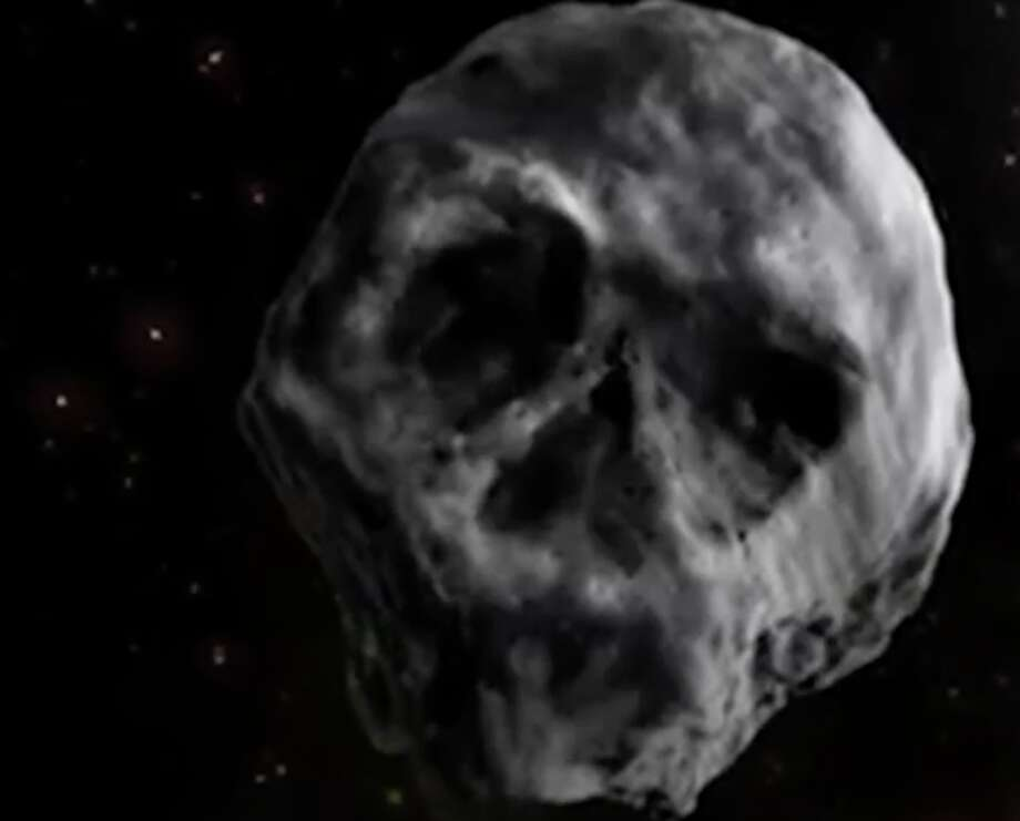 "An artist's rendition of Asteroid 2015 TB145, the so-called ""Halloween Asteroid"" enhances the rock's skull-like shape. The asteroid was discovered shortly before it arrived on Halloween Day 2015. Photo: Screen Shot Of Artist's Rendition"