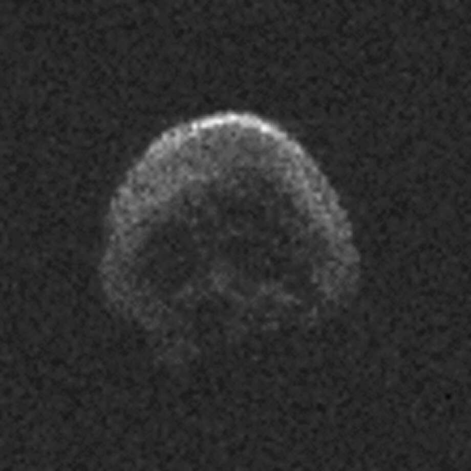 The Halloween Asteroid was discovered Oct. 10, 2015, by the University of Hawaii's Pan-STARRS-1 (Panoramic Survey Telescope and Rapid Response System) telescope in Haleakala, on the island of Maui. This image appeared to reveal indentations giving the asteroid skull-like features. Photo: NAIC-Arecibo/NSF