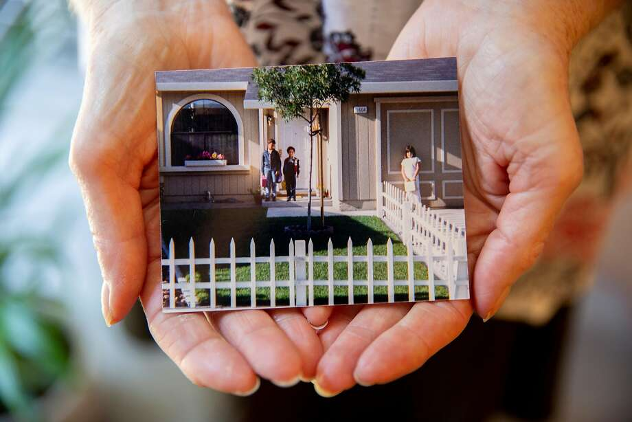 Astrid Granger shows a photo of the home that she and her husband, Henry, lived in for 30 years in Santa Rosa's Coffey Park neighborhood. Photo: Santiago Mejia / The Chronicle
