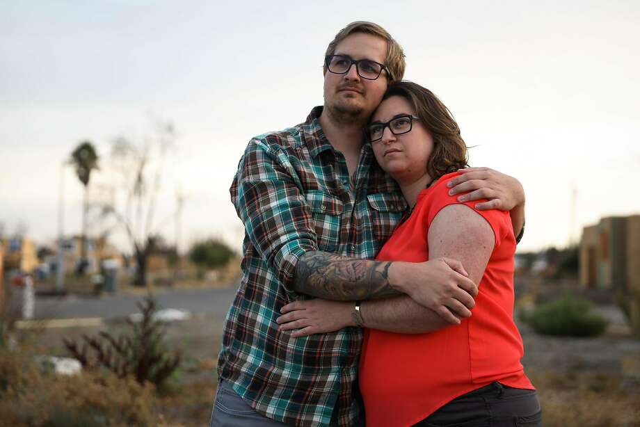Melissa Geissinger and husband Cole at the site of their home in Santa Rosa that was destroyed by the Tubbs Fire. Photo: Gabrielle Lurie / The Chronicle