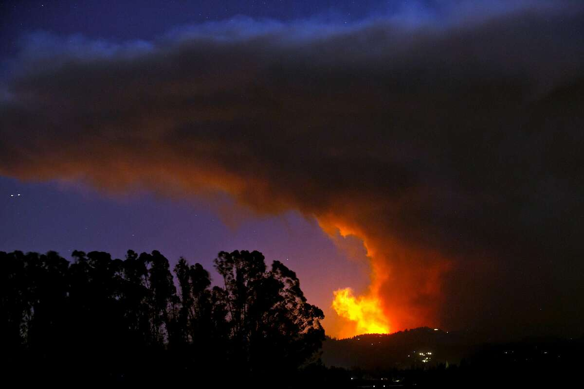 SANTA ROSA, CA - OCTOBER 9: A firestorm that began in Napa Valley's Calistoga, roars down the hills from Fountaingrove and into the Coffey Park and Orchard Mobile Home Park neighborhoods on October 9, 2017, in Santa Rosa, California. State officials are