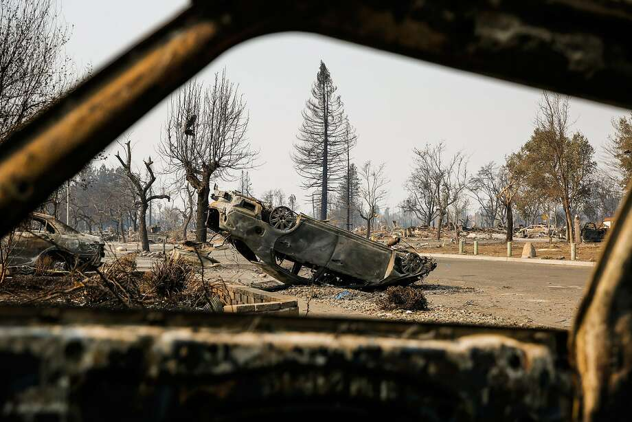 A car sits flipped over on Dogwood Drive in the Coffey Park neighborhood of Santa Rosa after the Tubbs Fire. The street, the main thoroughfare out of Coffey Park, was jammed with fleeing residents the night of the fire.  Photo: Gabrielle Lurie / The Chronicle 2017