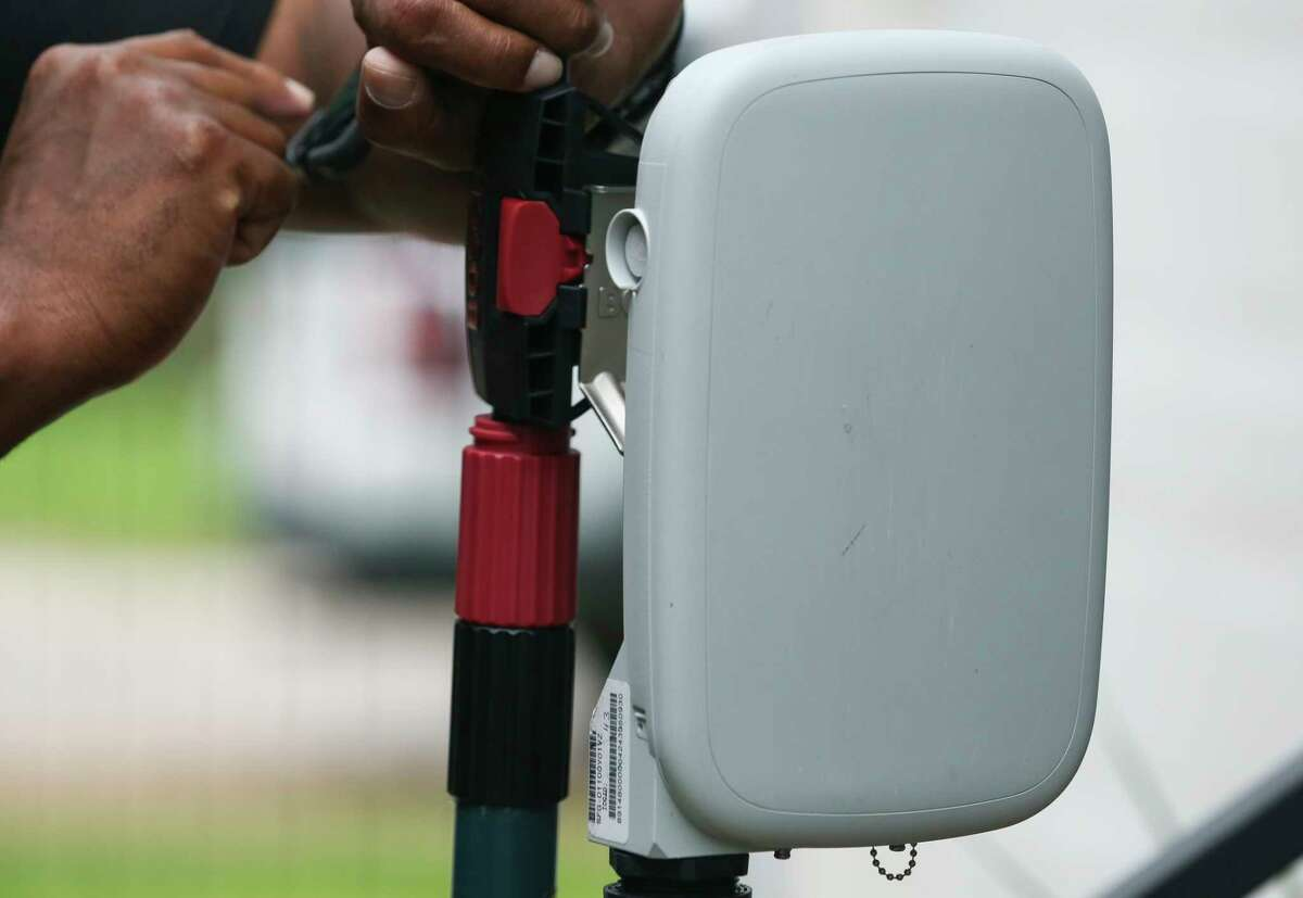 Verizon contractor Darryl McQueen, of Asurion, gets an antenna ready before he goes to test the 5G broadband signals at Clayton and Emily Harris' house in the Heights with on Monday, Oct. 1, 2018, in Houston. The Harrises were the first Verizon 5G broadband customers in the nation.