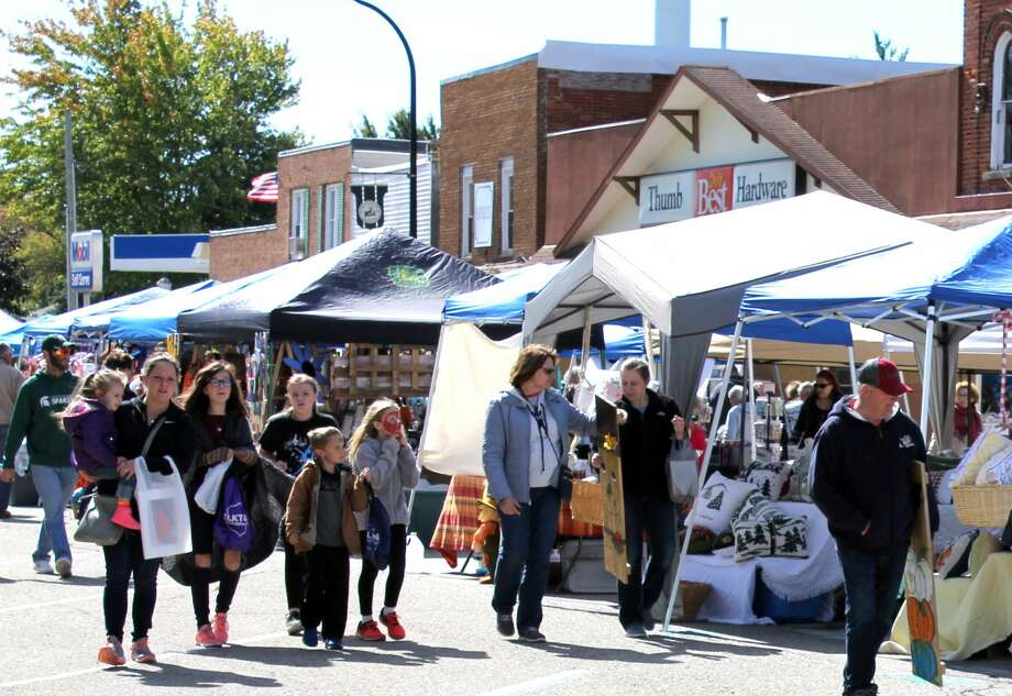 Shoppers of all ages gathered in Elkton Saturday for the village's Country Street Fair. The day included vendors, music, food and presentations for kids by police officers and firefighters. Photo: Brenda Battel/Huron Daily Tribune