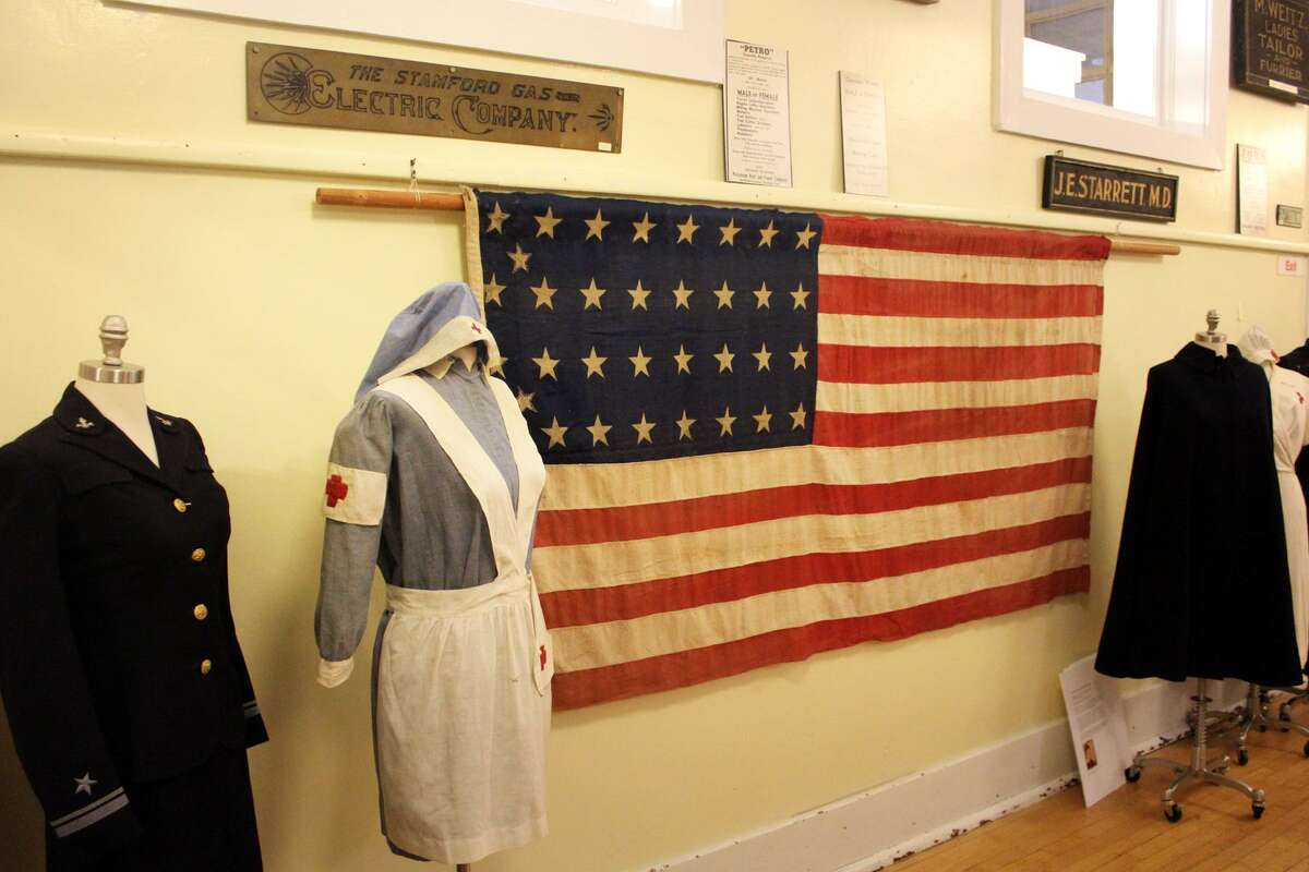 Volunteers Friday, Sept. 28, 2018, put the finishing touches on the Stamford History Center's new exhibition,