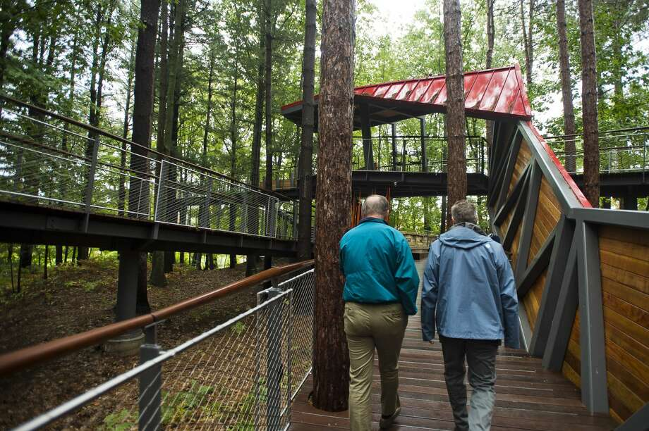 Members of the media take a tour of the Whiting Forest Canopy Walk on Monday, Oct. 1, 2018 in Midland. The facility, which features the longest canopy walk in the nation, is scheduled to open Sunday, Oct. 7. (Katy Kildee/kkildee@mdn.net) Photo: (Katy Kildee/kkildee@mdn.net)