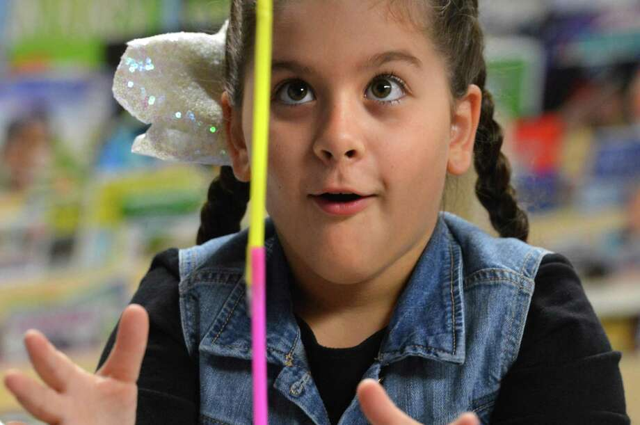 Tracey School 3rd grader Karina Kiriakidis reacts to their team building straw structure standing on its own during the opening of the school's new Curious Cub science lab on Monday October 1, 2018 in Norwalk Conn. Teams of students and parents had 20 minutes to design and build the tallest strcuture they could design using 100 straws and one roll of tape. Photo: Alex Von Kleydorff / Hearst Connecticut Media / Norwalk Hour