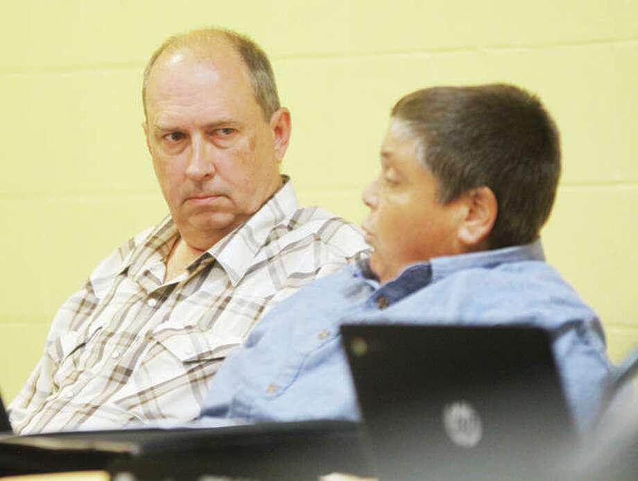 Godfrey Village Board Member Mark Stewart, left, listens as fellow Trustee Joseph Springman talks at a past board meeting during discussion on the potential sale of the village's wastewater sewer system to Illinois American Water Co. The village is expected to vote on the sale of the sewer system at Tuesday's meeting. Photo: Scott Cousins | The Telegraph
