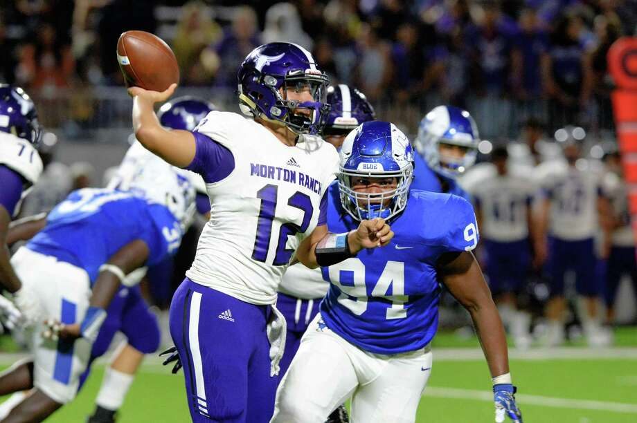 Jahmai Edwards (94) of Katy Taylor pressures quarterback Jaden Diaz (12) of Morton Ranch in the third quarter of a high school football game between the Katy Taylor Mustangs and Morton Ranch Mavericks on Saturday, Sept. 29, 2018, at Legacy Stadium in Katy. Photo: Craig Moseley, Houston Chronicle / Staff Photographer / ©2018 Houston Chronicle