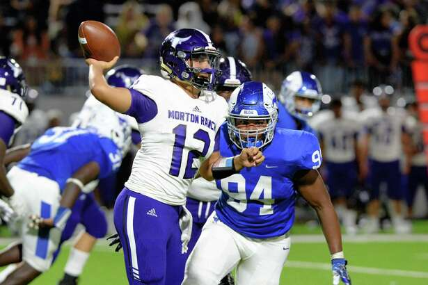 Jahmai Edwards (94) of Katy Taylor pressures quarterback Jaden Diaz (12) of Morton Ranch in the third quarter of a high school football game between the Katy Taylor Mustangs and Morton Ranch Mavericks on Saturday, Sept. 29, 2018, at Legacy Stadium in Katy.