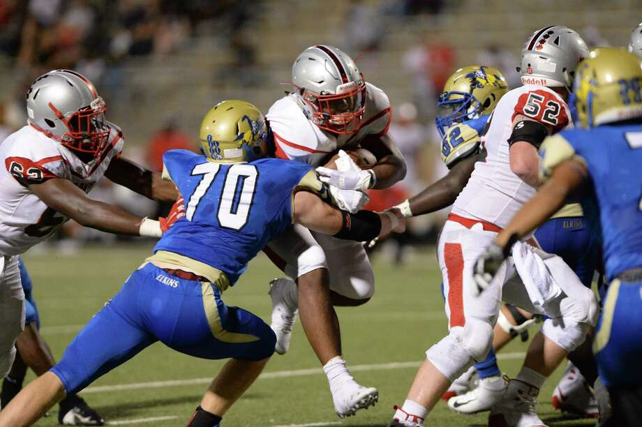 Kaelen Shankle (8) of Travis powers in for a one yard touchdown in the fourth quarter of a high school football game between the Elkins Knights and the Travis Tigers on Thursday, September 27, 2018 at Hall Stadium, Missouri City, TX. Photo: Craig Moseley, Houston Chronicle / Staff Photographer / ©2018 Houston Chronicle