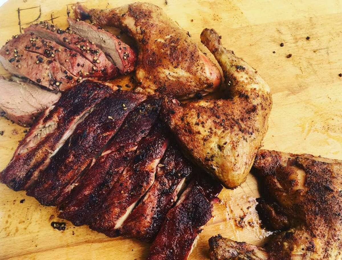 An assortment of meats cooked on the pellet grill for Chuck's Food Shack include tri-tip beef, chicken quarters and pork ribs.