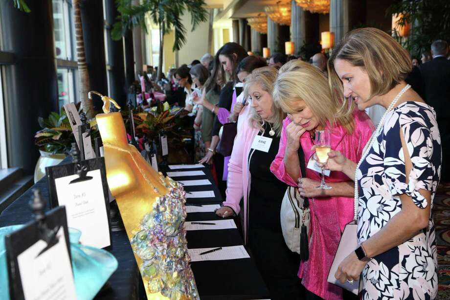 People browse through auction items during a previous year's luncheon event, held by the Nancy Owens Breast Cancer Foundation. Photo: TK Images / TK Images exclusively owns &retains all rights, including copyright, to all photographs &images, in any form, including digital