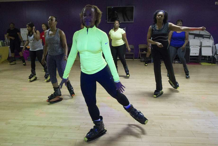 Mia Trevillion, middle, leads a Groove Bounce Fun fitness class with Kangoo jumping boots on Tuesday, March 17, 2015, in Houston. The boots provide a bouncy, low-impact workout. (J. Patric Schneider / For the Chronicle ) Photo: J. Patric Schneider, Freelance / For The Chronicle / © 2015 Houston Chronicle