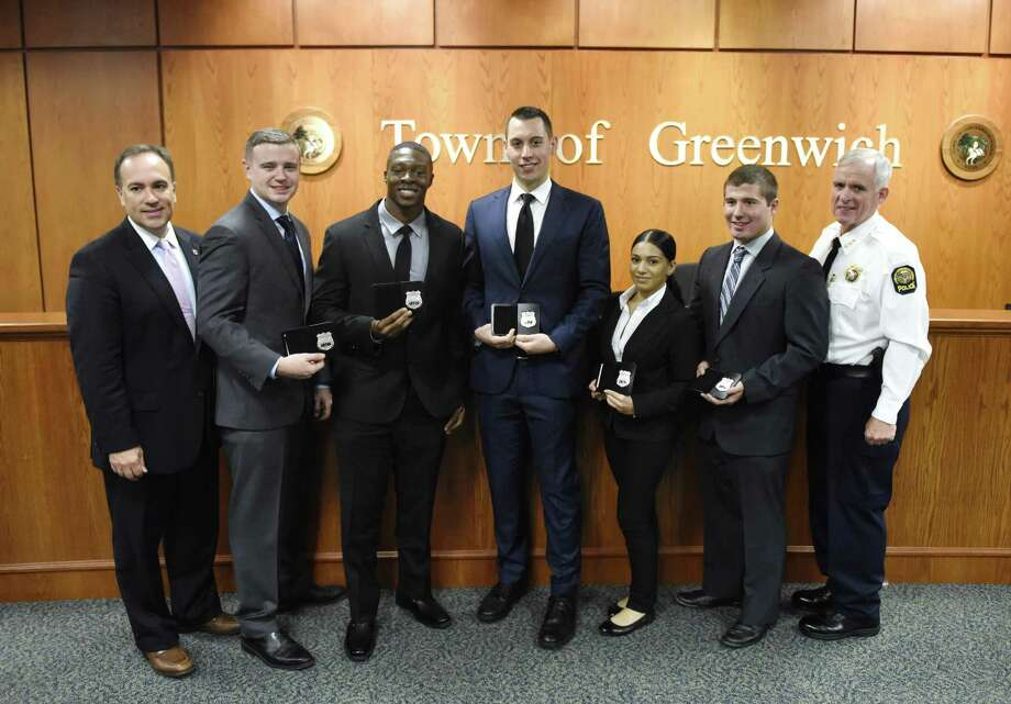 Police Commissioner and First Selectman Peter Tesei, far left, and Chief of Police James Heavey, far right, pose with new police recruits, from left, Kevin Ingraham, Allen Arrington, William O'Connor, Erica Rosario, and Christopher Manjuck at the swearing-in ceremony for new Greenwich police officers at Town Hall in Greenwich on Monday. Five new police recruits, Allen Arrington, Kevin Ingraham, Christopher Manjuck, William O'Connor and Erica Rosario, were sworn in on Monday. Photo: Tyler Sizemore / Hearst Connecticut Media / Greenwich Time