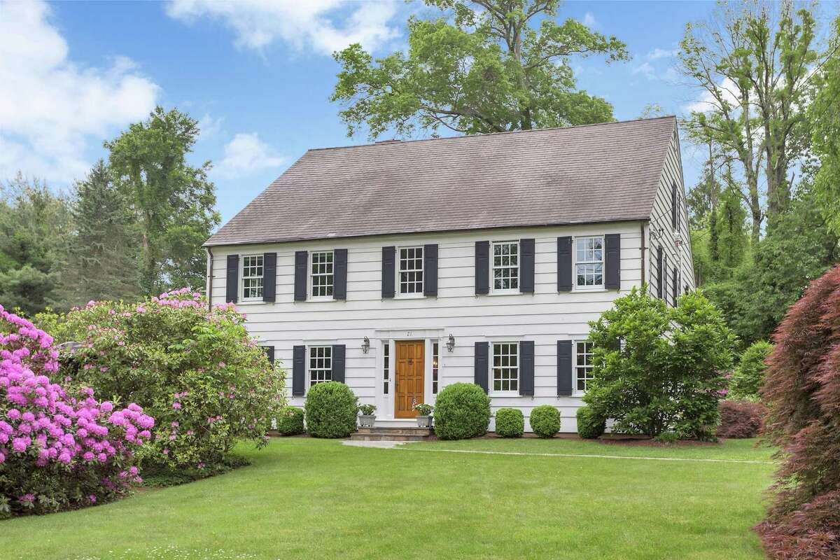 The 1916 classic center hall colonial is on 1.1 acres with a professionally landscaped yard, mature rhododendrons and specimen plantings.