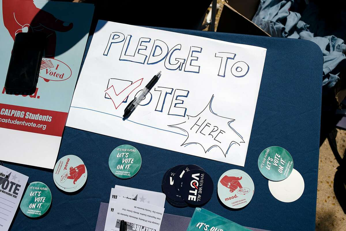 Various voting swag is seen on a VoteCrew table during an event encouraging students to vote during National Voter Registration Day on the UC Berkeley campus in Berkeley, Calif., on Tuesday September 25, 2018